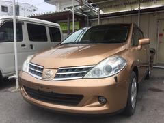 沖縄の中古車 日産 ティーダ 車両価格 38万円 リ済込 平成20年 5.8万K ゴールド