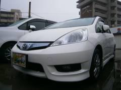 沖縄の中古車 ホンダ フィットシャトルハイブリッド 車両価格 119万円 リ済込 平成24年 8.2万K パールホワイト