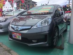 沖縄の中古車 ホンダ フィットハイブリッド 車両価格 89万円 リ済込 平成24年 8.9万K ガンM