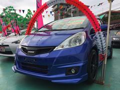 沖縄の中古車 ホンダ フィットハイブリッド 車両価格 89万円 リ済込 平成23年 9.4万K ブルーM
