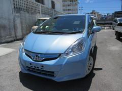 沖縄の中古車 ホンダ フィットハイブリッド 車両価格 91万円 リ済込 平成24年 7.0万K ライトブルーM