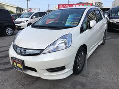 沖縄の中古車 ホンダ フィットシャトルハイブリッド 車両価格 125万円 リ済込 平成24年 4.3万K パールホワイト
