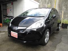 沖縄の中古車 ホンダ フィットハイブリッド 車両価格 105万円 リ済込 平成24年 5.6万K ブラック