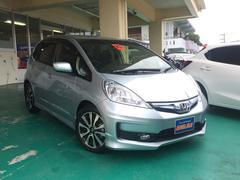 沖縄の中古車 ホンダ フィットハイブリッド 車両価格 97万円 リ済込 平成25年 4.5万K ライトブルーM