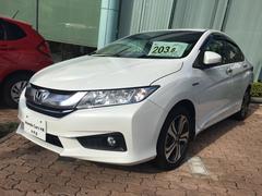 沖縄の中古車 ホンダ グレイス 車両価格 203.8万円 リ済込 平成28年 0.6万K パールホワイト