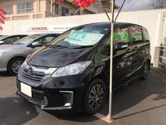 沖縄の中古車 ホンダ フリードハイブリッド 車両価格 192.8万円 リ済別 平成28年 1.0万K ブラック