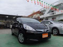 沖縄の中古車 ホンダ フィットハイブリッド 車両価格 62万円 リ済込 平成23年 8.6万K Dブラック