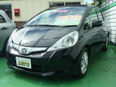 沖縄の中古車 ホンダ フィットハイブリッド 車両価格 75万円 リ済別 平成24年 7.2万K クリスタルブラックパール