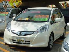 沖縄の中古車 ホンダ フィットハイブリッド 車両価格 69万円 リ済別 平成23年 7.5万K プレミアムホワイトパール