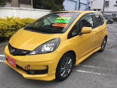 沖縄の中古車 ホンダ フィット 車両価格 99万円 リ済別 平成23年 5.5万K イエロー