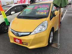 沖縄の中古車 ホンダ フィットハイブリッド 車両価格 65万円 リ済込 平成23年 8.0万K イエロー