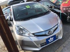 沖縄の中古車 ホンダ フィットハイブリッド 車両価格 49万円 リ済込 平成22年 9.5万K シルバーM