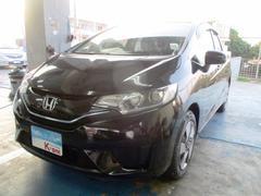 沖縄の中古車 ホンダ フィットハイブリッド 車両価格 119万円 リ済込 平成27年 0.9万K クリスタルブラックパール