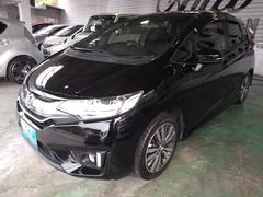 沖縄の中古車 ホンダ フィットハイブリッド 車両価格 138万円 リ済込 平成25年 5.5万K ブラック