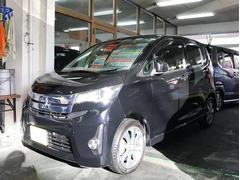 沖縄の中古車 三菱 eKカスタム 車両価格 64万円 リ済別 平成25年 8.4万K ブラック