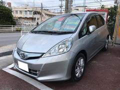 沖縄の中古車 ホンダ フィットハイブリッド 車両価格 55万円 リ済別 平成23年 8.6万K シルバー