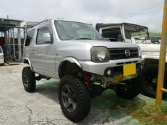 沖縄の中古車 マツダ AZオフロード 車両価格 65万円 リ済込 平成18年 12.1万K シルバー