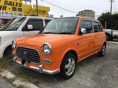 沖縄の中古車 ダイハツ ミラジーノ 車両価格 19万円 リ済込 平成11年 13.8万K オレンジII