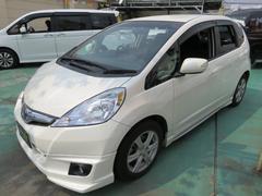 沖縄の中古車 ホンダ フィットハイブリッド 車両価格 94万円 リ済込 平成22年 7.1万K パールホワイト