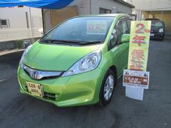 沖縄の中古車 ホンダ フィットハイブリッド 車両価格 59万円 リ済込 平成23年 7.3万K グリーン