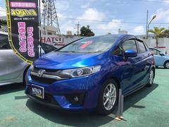 沖縄の中古車 ホンダ フィットハイブリッド 車両価格 127万円 リ済込 平成25年 2.8万K ブルーM