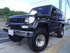 沖縄の中古車 トヨタ ランドクルーザープラド 車両価格 129万円 リ済別 平成7年 26.0万K ブラック