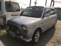沖縄の中古車 ダイハツ ミラジーノ 車両価格 37万円 リ済込 平成16年 7.2万K シルバー