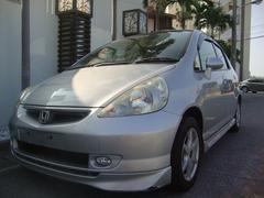 沖縄の中古車 ホンダ フィット 車両価格 19万円 リ済込 平成14年 8.4万K シルバー