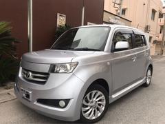 沖縄の中古車 トヨタ bB 車両価格 29万円 リ済込 平成18年 メータ交換8.1万K シルバー
