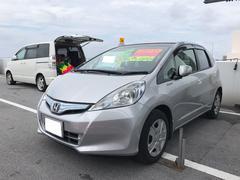 沖縄の中古車 ホンダ フィットハイブリッド 車両価格 65万円 リ済込 平成24年 5.9万K シルバー