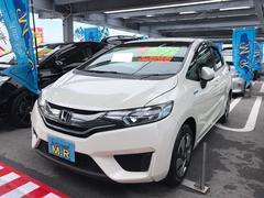 沖縄の中古車 ホンダ フィットハイブリッド 車両価格 99万円 リ済込 平成25年 5.0万K ホワイト