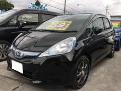 沖縄の中古車 ホンダ フィットハイブリッド 車両価格 55万円 リ済込 平成23年 7.2万K クリスタルブラックパール
