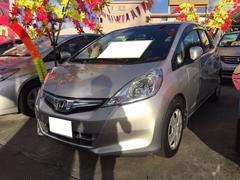 沖縄の中古車 ホンダ フィットハイブリッド 車両価格 65万円 リ済込 平成23年 7.6万K シルバー