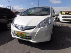 沖縄の中古車 ホンダ フィットハイブリッド 車両価格 55万円 リ済込 平成22年 7.5万K パールホワイト