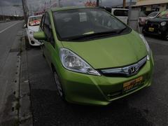 沖縄の中古車 ホンダ フィットハイブリッド 車両価格 59万円 リ済込 平成23年 6.0万K Lグリーン