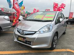 沖縄の中古車 ホンダ フィットハイブリッド 車両価格 59万円 リ済込 平成24年 7.7万K シルバー