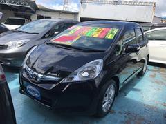 沖縄の中古車 ホンダ フィットハイブリッド 車両価格 59万円 リ済別 平成23年 9.5万K クリスタルブラックパール