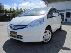 沖縄の中古車 ホンダ フィットハイブリッド 車両価格 77万円 リ済込 平成24年 6.7万K パールホワイト