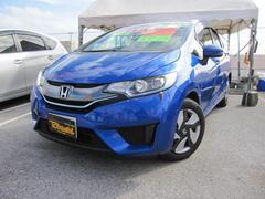 沖縄の中古車 ホンダ フィットハイブリッド 車両価格 124万円 リ済込 平成26年 7.5万K ブルーM