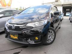 沖縄の中古車 ホンダ フィットハイブリッド 車両価格 118万円 リ済込 平成25年 7.3万K クリスタルブラックパール