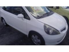 沖縄の中古車 ホンダ フィット 車両価格 4.9万円 リ済込 平成15年 7.5万K ホワイト