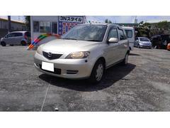 沖縄の中古車 マツダ デミオ 車両価格 19.8万円 リ済込 平成15年 13.4万K ライトゴールド