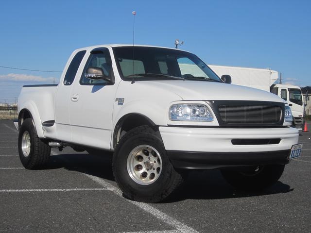 フォード ラリアット HDDナビ リフトアップ 新車並行