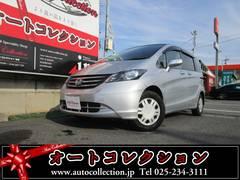 新潟県の中古車ならフリード フレックス タイミングチェーン車 HID キーレス付