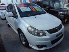 沖縄の中古車 スズキ SX4 車両価格 45万円 リ済込 平成18年 7.8万K パールホワイト