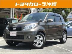 沖縄の中古車 トヨタ ラッシュ 車両価格 159万円 リ済別 平成24年 2.4万K ライトゴールド