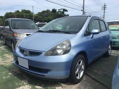 沖縄の中古車 ホンダ フィット 車両価格 19万円 リ済込 平成13年 17.3万K ライトブルー