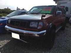 沖縄の中古車 日産 ダットサンピックアップ 車両価格 87万円 リ済込 平成13年 26.0万K オレンジII