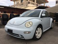 沖縄の中古車 フォルクスワーゲン VW ニュービートル 車両価格 19万円 リ済込 2001年 9.9万K ライトブルーM