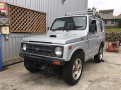 沖縄の中古車 スズキ ジムニー 車両価格 25万円 リ済込 平成7年 14.5万K マーキュリーシルバーメタリック